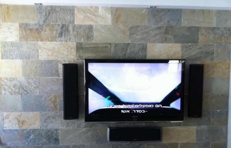 Tv mounting with sound system installation